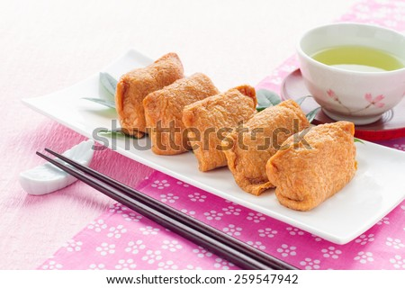 japanese sushi, flavored boiled rice wrapped in fried bean curd