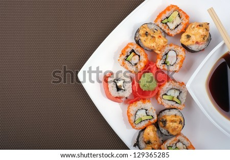 Japanese sushi on a plate with space for text. Top view