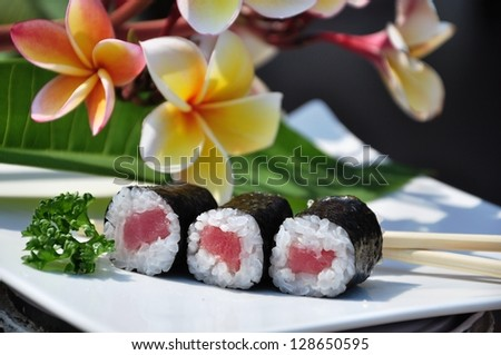 Japanese sushi on a white plate. Three roll.