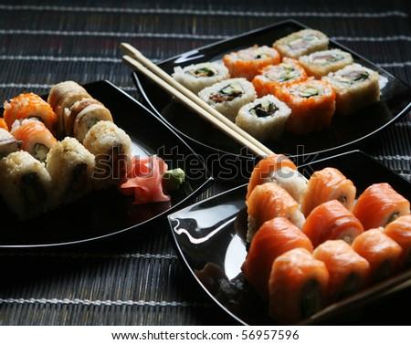 Japanese sushi on black plate - stock photo