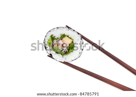 Japanese Sushi rolls with brown chopsticks isolated on white background