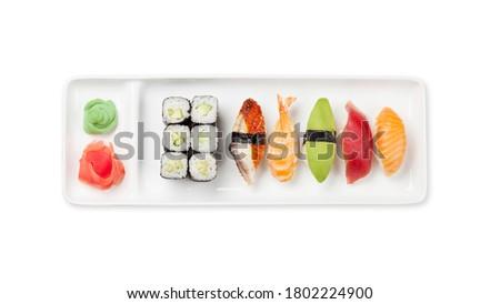 Japanese sushi set. Sashimi, maki rolls on plate. Top view flat lay isolated on white background