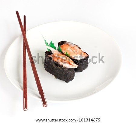 japanese sushi traditional food on plate with chopsticks