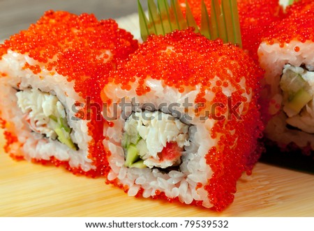 Japanese sushi  traditional japanese food.Roll made of Smoked fish and red caviar - stock photo