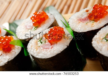 Japanese sushi  traditional japanese food.Roll made of Smoked fish and red roe
