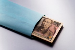 Japanese ten-thousand yen bill bundle in paper bag