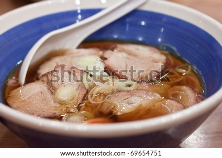 Japanese tradition noodle serve with pork sliced and green onions
