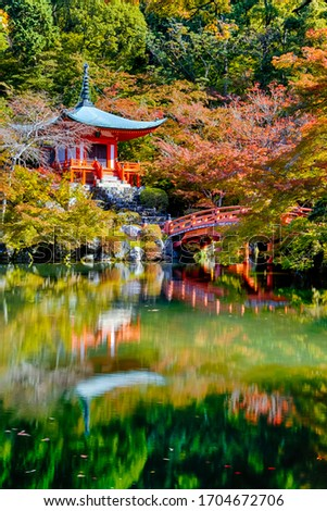 Japanese Traveling. Famous Daigo-ji Temple During Beautiful Red Maples Autumn Season at Kyoto City in Japan. With Pond Reflections in Foregorund. Vertical Composition Stock photo ©