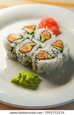 Japanese tuna sushi roll with pickled ginger and wasabi