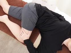 Japanese woman doing self massage / stretch