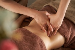 Japanese woman getting a belly massage at a beauty salon