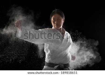 Japanese woman giving a hit to the punching bag
