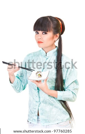 Japanese woman in a nice suit. she holds a plate with rolls