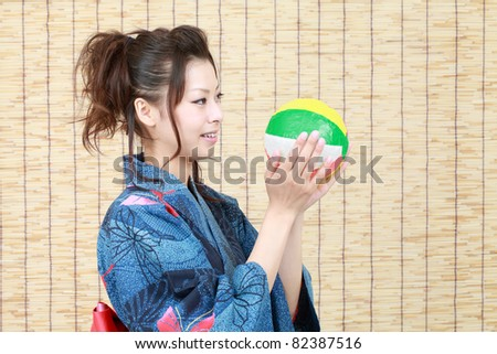Japanese woman in traditional clothes of Kimono with Paper balloon