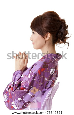 Japanese woman praying, closeup portrait of Asian lady in traditional clothes, kimono.