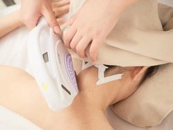 Japanese woman receiving nape photo epilation