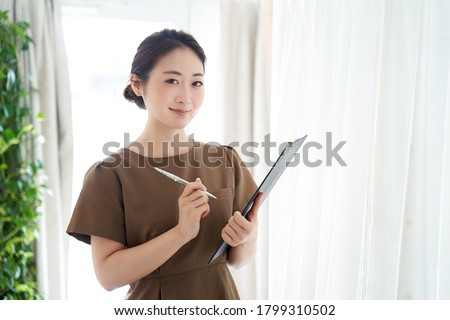 Japanese woman working at an aesthetic salon ストックフォト ©