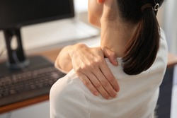 Japanese women businesswoman whose shoulders hurt from working from home
