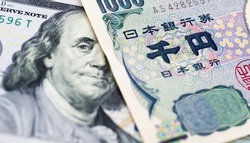 Japanese Yen and USD dollar bank note, currency exchange rate