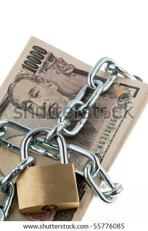 japanese yen notes with lock and chain. Money stack for safety and investment.