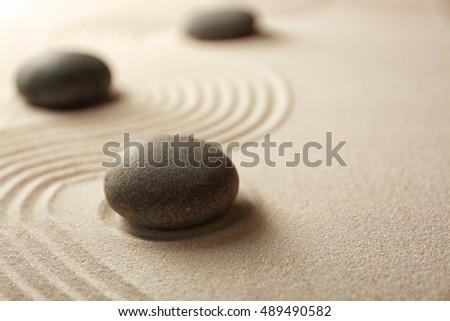 Japanese Zen garden. Pebbles on a sand #489490582