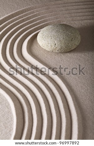 japanese zen garden sand and rocks or stones from calm linear pattern leading to spiritual balance