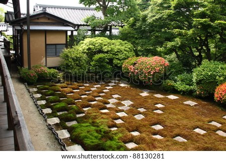 Japanese zen garden: square cutted stones and moss in a chequered pattern.
