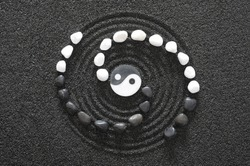 Japanese ZEN garden with yin and yang stone in raked sand