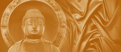 Japaneses style buddha statue on abstract golden tone background