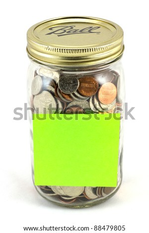 Jar full of coins with a blank sign for your message.