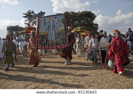JAR MADA, ADDIS ABABA -  JAN 18:  Christian Orthodox devotees carry religious pictures at the Timket Festival. January 18, 2009 in Jar Mada, Addis Ababa, Ethiopia