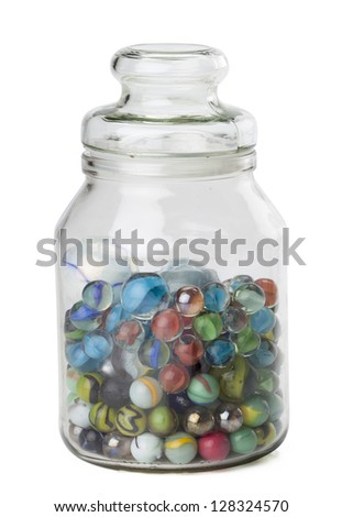 Jar of assorted marbles isolated in a white background