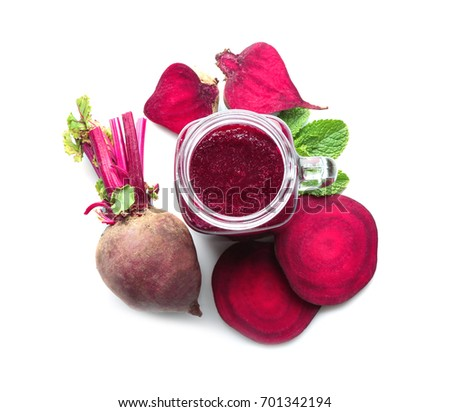 Jar of beet smoothie on white background