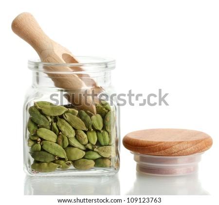 Jar of cardamom isolated on white close-up