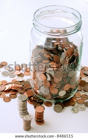 Jar of coins, stacks and scattered coins around jar, white background - stock photo