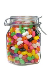 Jar of Colorful Jelly Beans Isolated on White