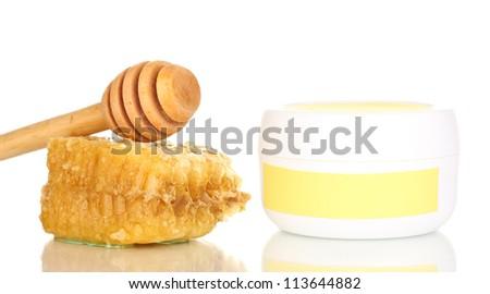 Jar of cream with honey isolated on white