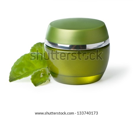 jar of green cream isolated on white background.