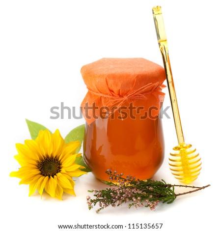 Jar of honey and herbs