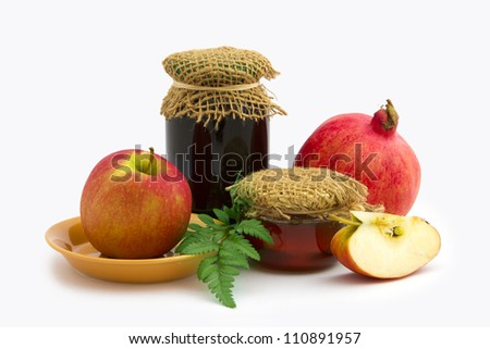 Jar of honey, apple and pomegranate on white background