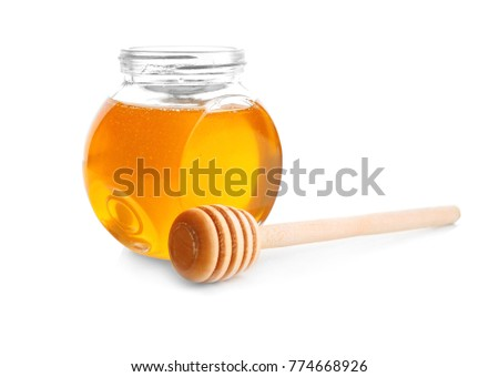 Jar of honey with dipper, isolated on white #774668926