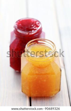 jar of orange and raspberry jam - food and drink