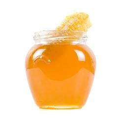 jar of organic honey on white background