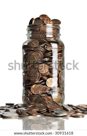 stock photo : Jar of pennies overflowing