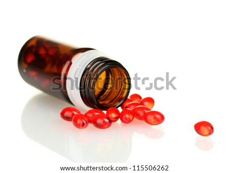 Jar of pills isolated on white