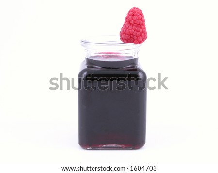jar of raspberry syrup isolated on white