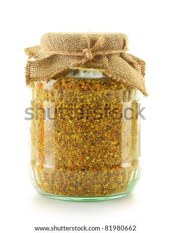 Jar with bee pollen isolated on white. Nutritional supplement