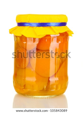 Jar with canned apricots isolated on white