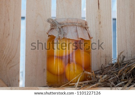 Jar with conservation on a wooden background #1101227126