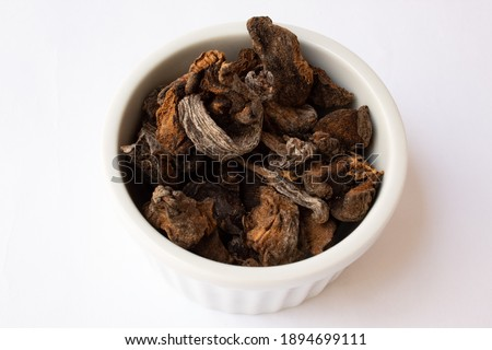 Jar with dry funghi mushroom isolated on white background Foto d'archivio ©